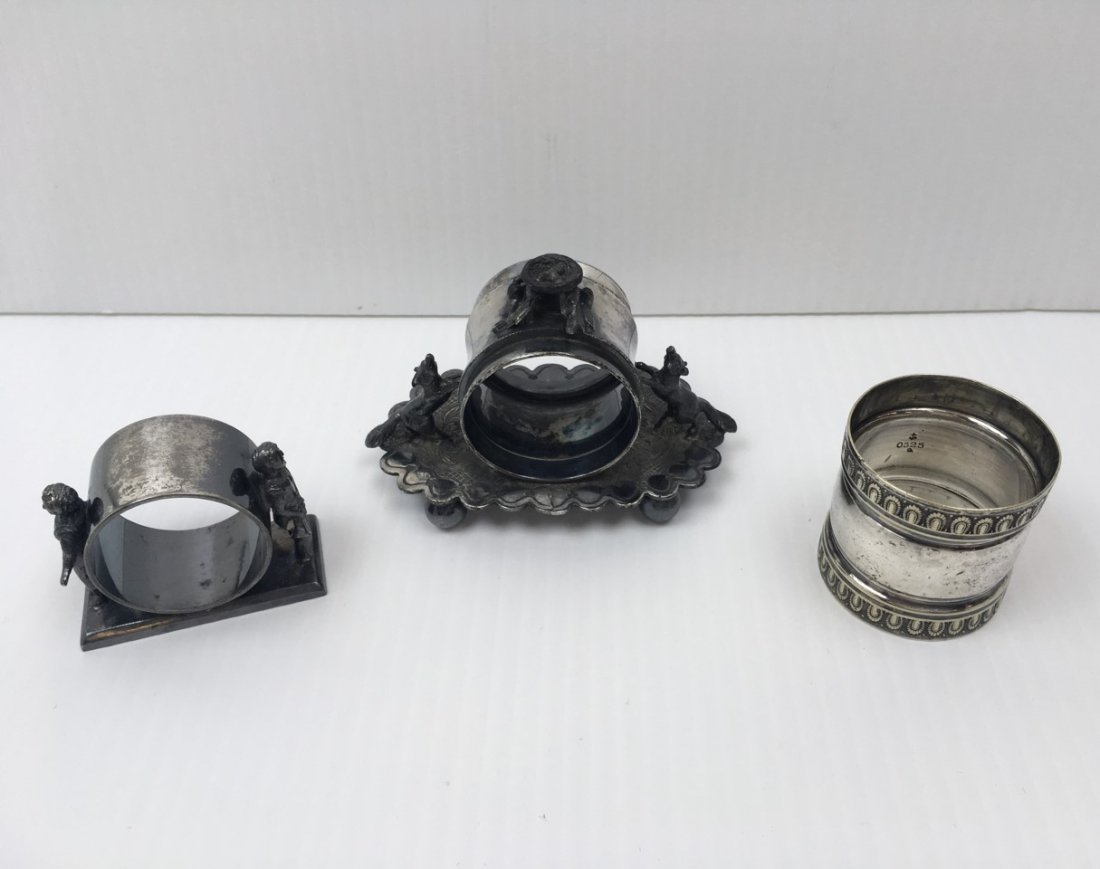 3 ANTIQUE SILVER PLATE NAPKIN RINGS