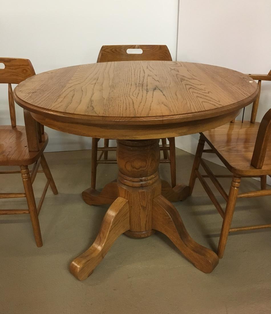OAK TABLE WITH 4 BARREL BACK OAK CHAIRS - 4
