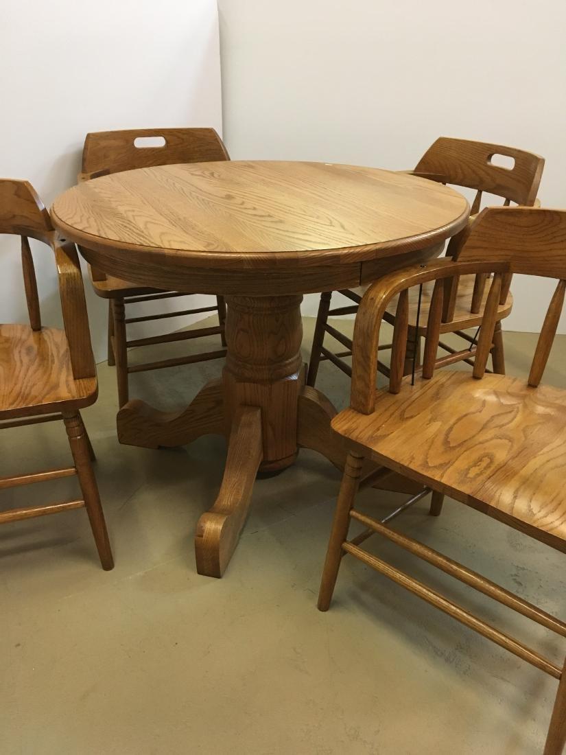 OAK TABLE WITH 4 BARREL BACK OAK CHAIRS - 2