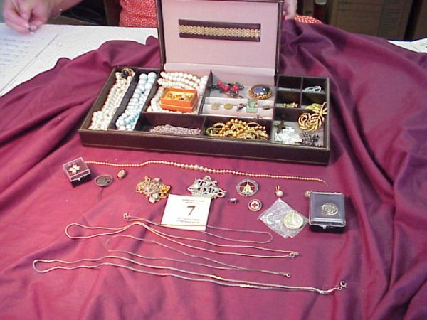 7J: Large Assortment of Costume Jewelry and dresser van