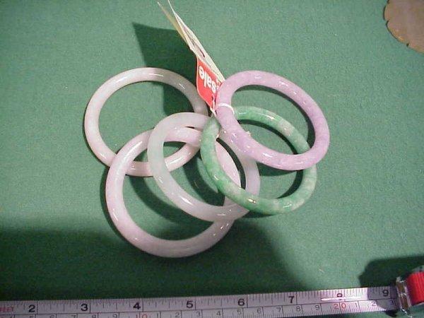 64J: 5 Jade Bangle Bracelets 2) green, 2) white, 1) lav