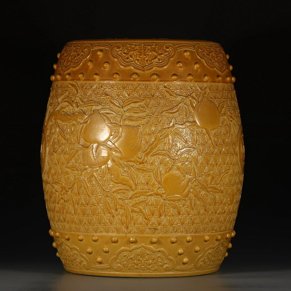 A Chinese Yellow Glazed Peach Piercing Porcelain Drum