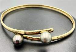 18k yellow gold bracelet w two 74mm pearls 18k yellow