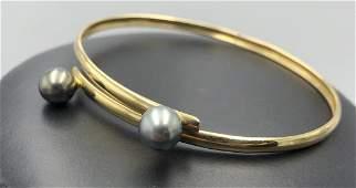18k yellow gold bracelet w two 74mm pearls 18k yellow