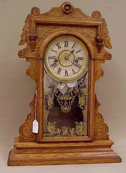 "17: Waterbury Kitchen Clock, Oak Gingerbread Case, 21"""