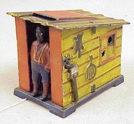1113: Cast Iron Cabin Mechanical Bank