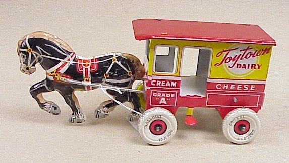 """1120: Tin Wind up """"Toy Town Dairy"""" Marx"""