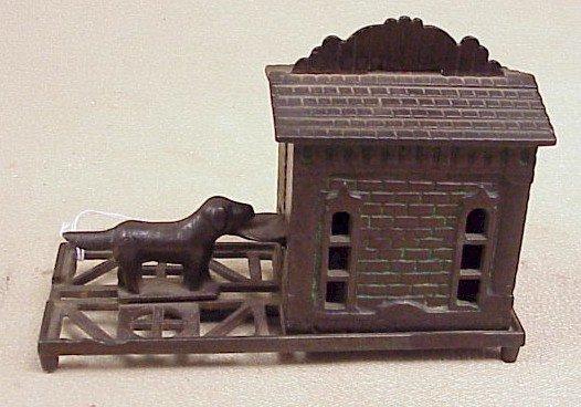 1121: Vintage Cast Iron Gem Bank