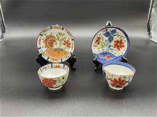 Two Gaudy Dutch Cups and Saucers