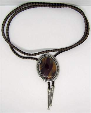LEATHER BOLO TIE WITH SILVER TONED POLISHED