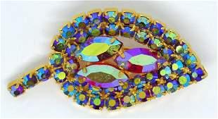 VINTAGE GOLD TONED LEAF BROOCH WITH BLUE