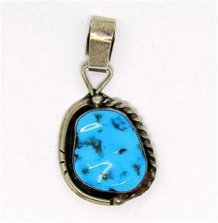 NAVAJO STERLING PENDANT WITH TURQUOISE