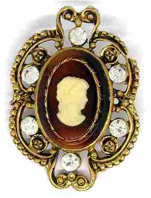 VINTAGE GOLD TONED CAMEO BROOCH WITH