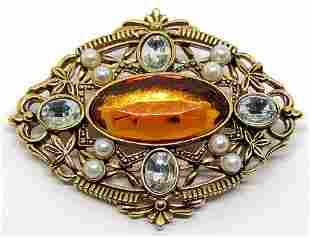 VINTAGE AVON GOLD TONED BROOCH WITH ORANGE