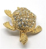 GIVENCHY PARIS/NEW YORK MARKED TURTLE PIN