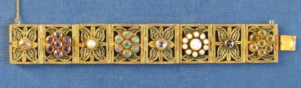 42: A Lady's 14k Gold Filigree Panel Bracelet