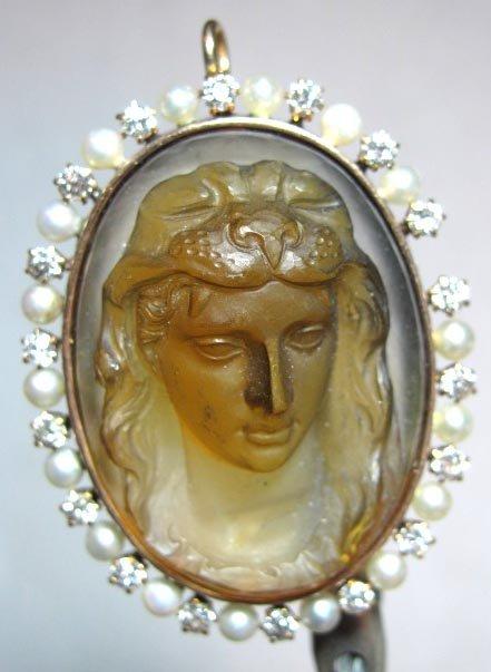 46: A Lady's Quartz & 14k Gold Cameo Brooch