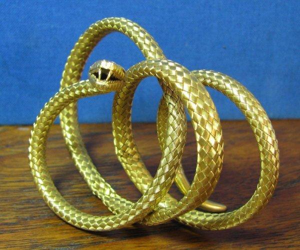 47: A Lady's 18k Coil Snake Bracelet