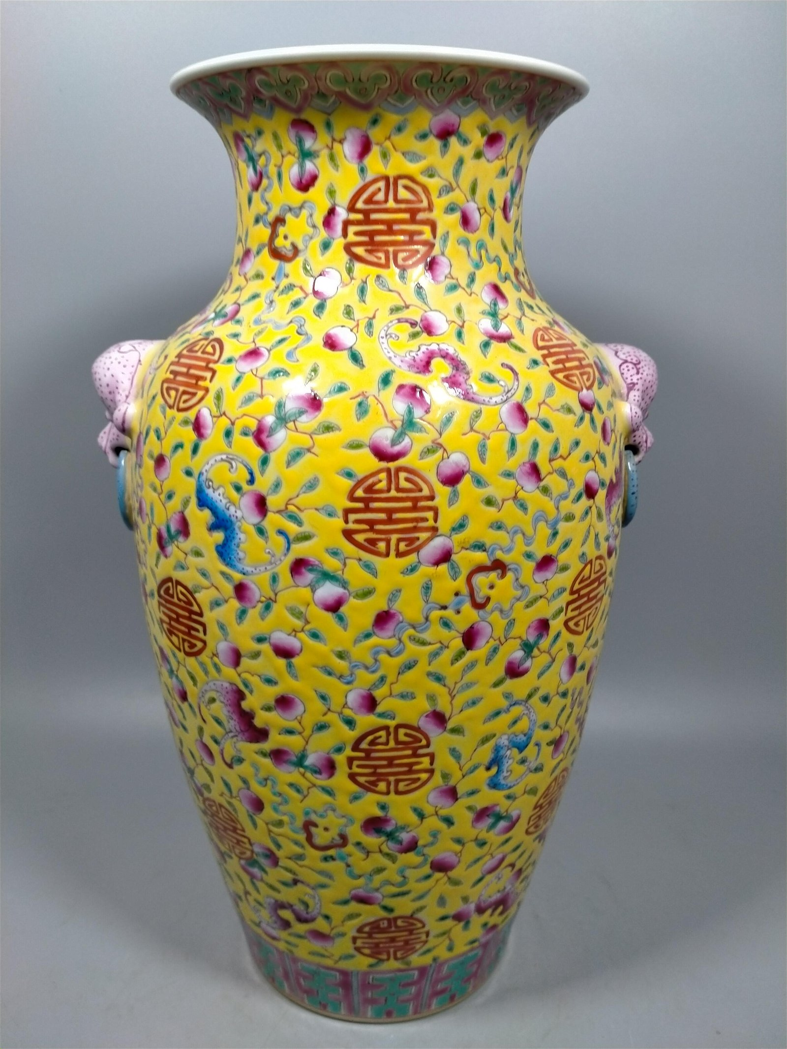 Famille rose painted vase with yellow glaze