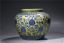 CHINESE. A YELLOW GROUND BLUE AND WHITE JAR