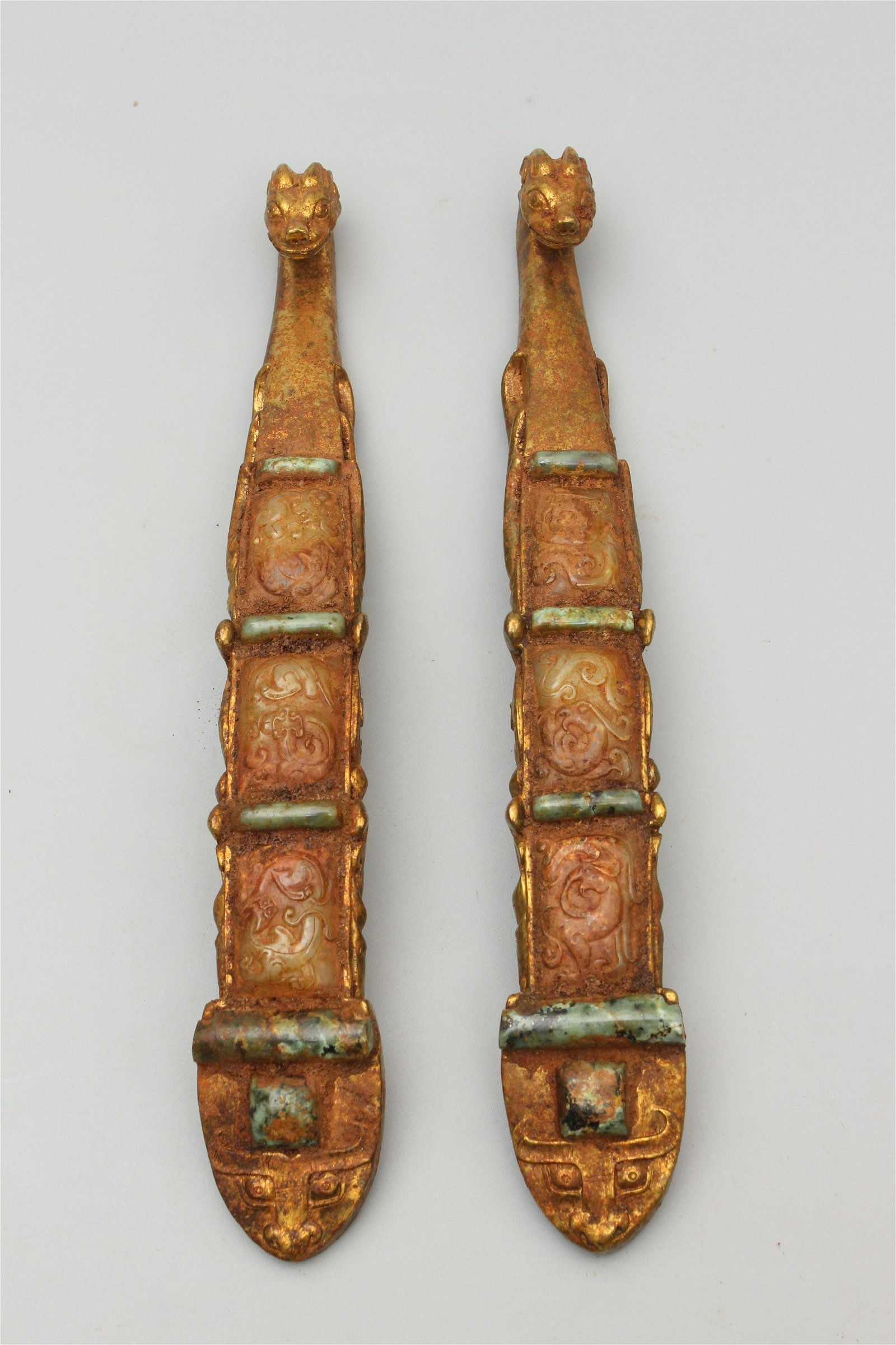A Pair of Chinese Jade-Inlaid Gilt Bronze Belt Buckles