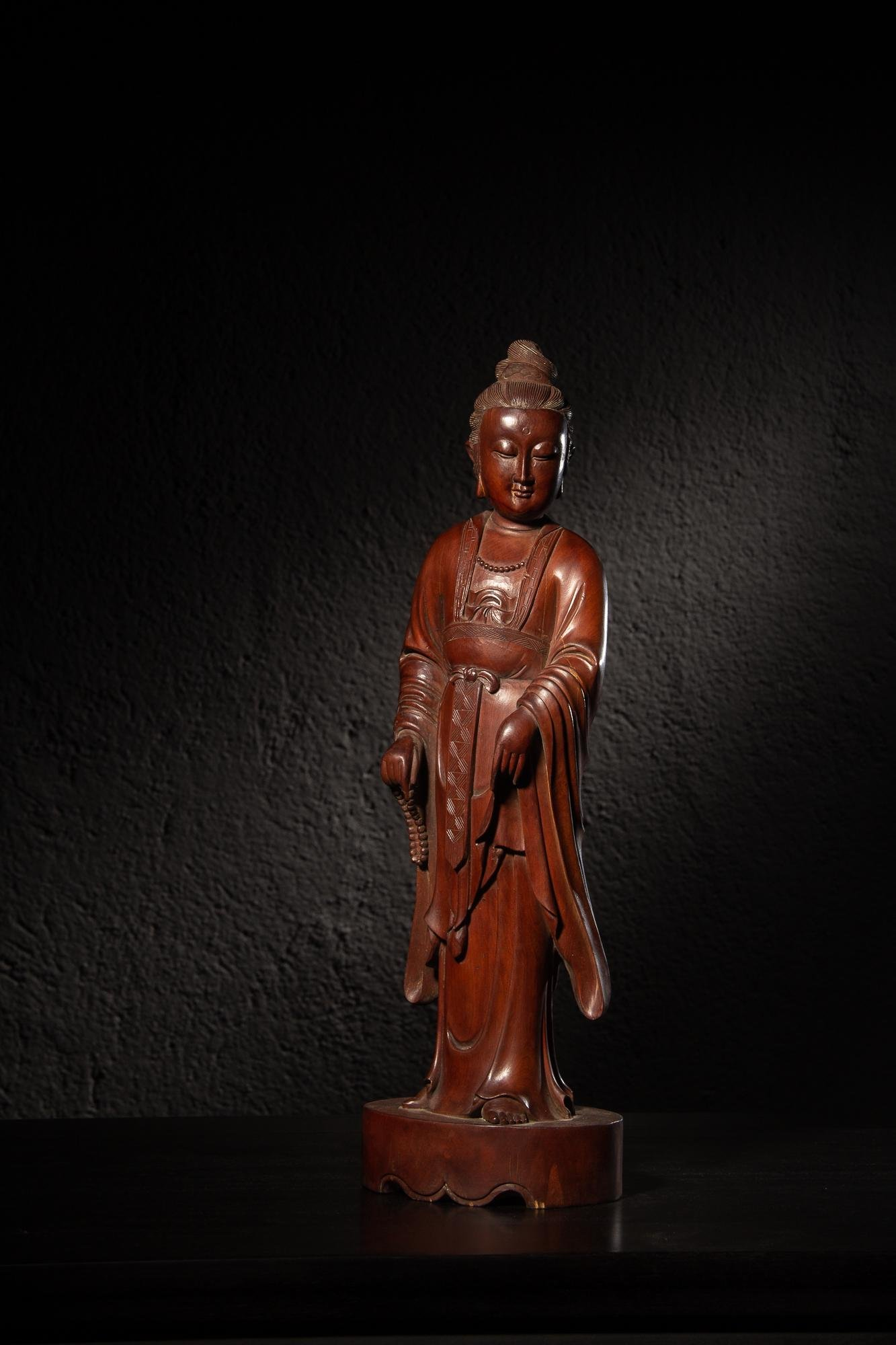 A Carved Wooden Standing Guanyin