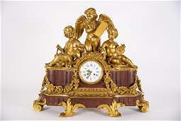 A Monumental French Gilt Bronze and Rouge Marble Clock,