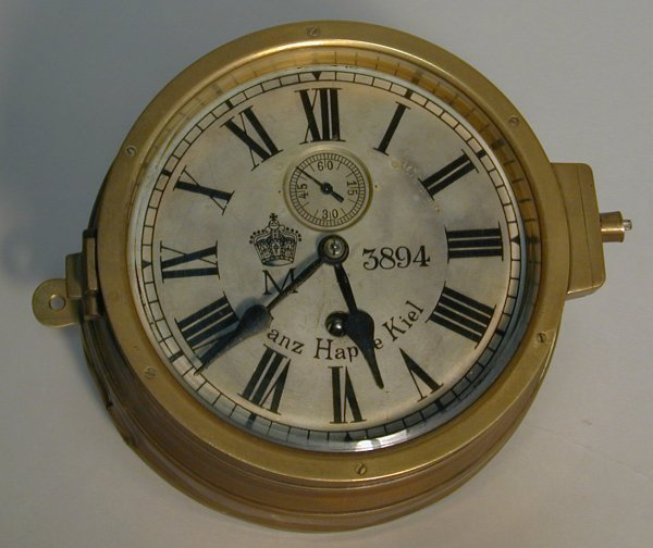 196: A brass cased German Navy U-Boat clock with silver