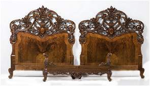 Couple of beds in carved mahogany
