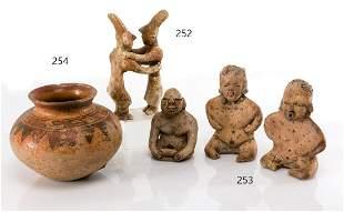 Three pre-Columbian Olmec figurines