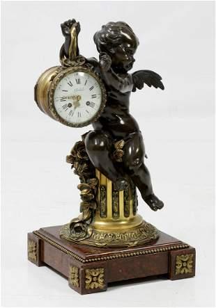 Bronze clock with angel figure