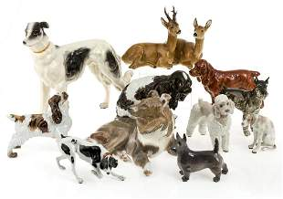 11 porcelain groups of dogs and deer