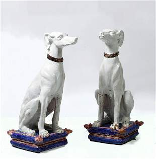 Pair of earthenware dog figurines
