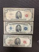 5 dollar bills red and blue all three one money