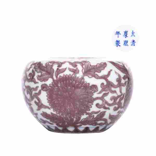 A CHINESE UNDERGLAZED RED PORCELAIN ZUN