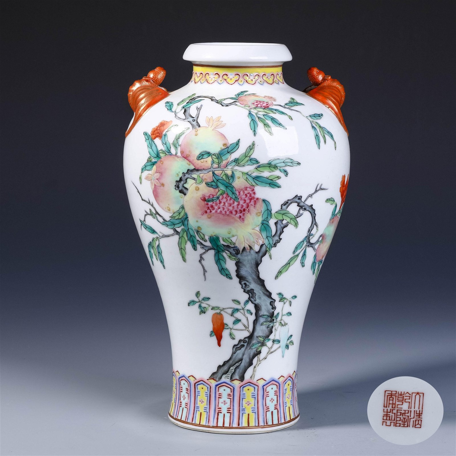 A CHINESE FAMILLE ROSE PORCELAIN DOUBLE EARS ZUN