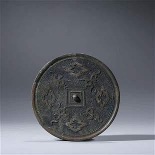 A CHINESE BRONZE PHOENIX MIRROR