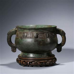 A CHINESE BRONZE STEAMING VESSEL WITH WOOD STAND