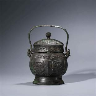A CHINESE BRONZE WINE VESSEL & COVER