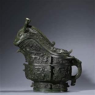 A CHINESE BEAST-SHAPED-HEAD BRONZE WINE VESSEL