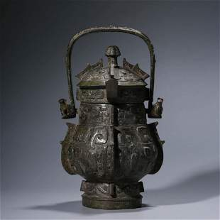 A CHINESE BRONZE WINE VESSEL WITH COVER