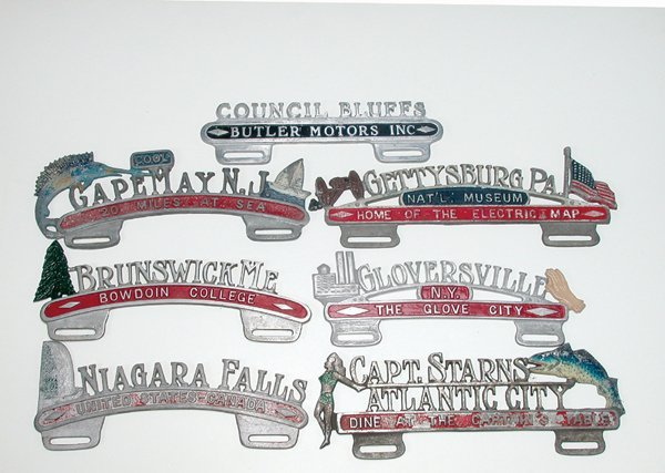 109: SEVEN ORIGINAL VINTAGE LICENSE PLATE TOPPERS