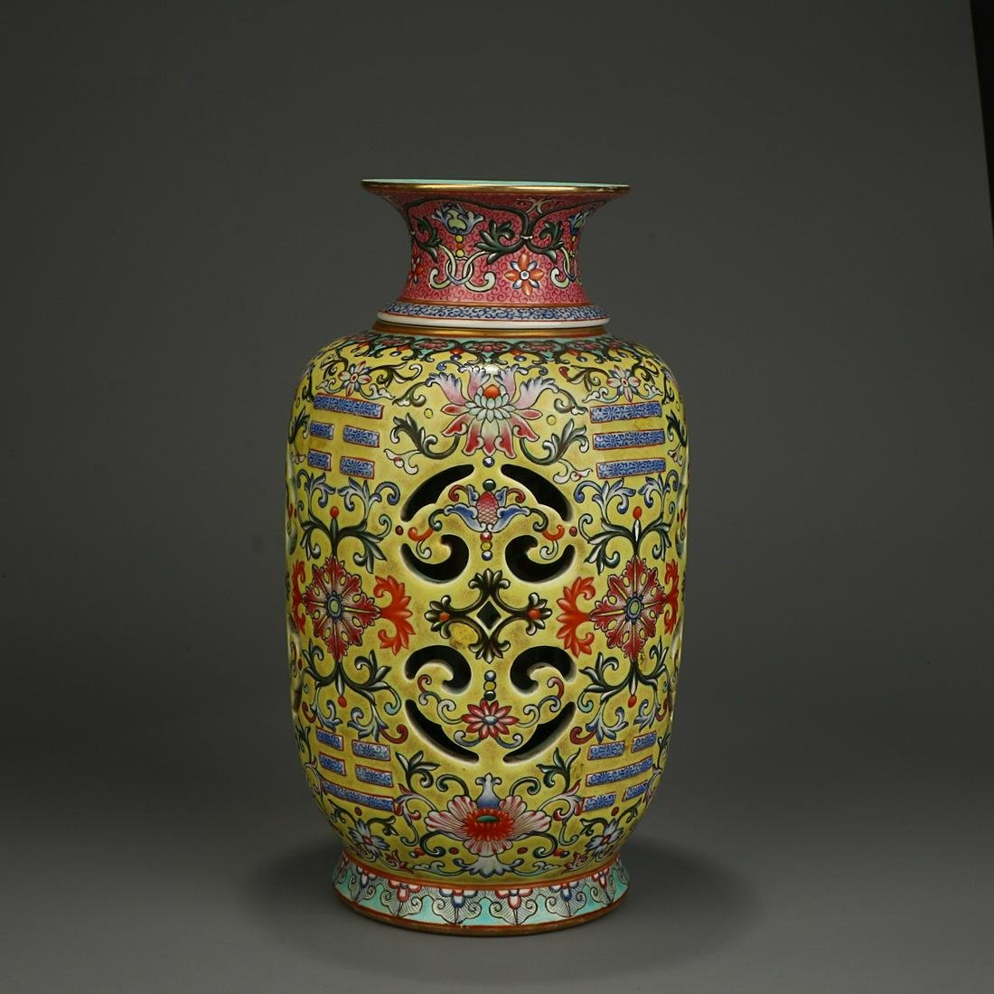 YELLOW GROUND FAMILLE ROSE 'FLORAL' VASE WITH ROTATING