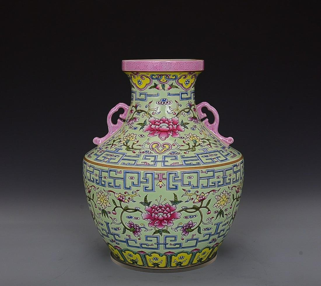 GREEN GROUND FAMILLE ROSE 'FLORAL' VASE WITH HANDLES,