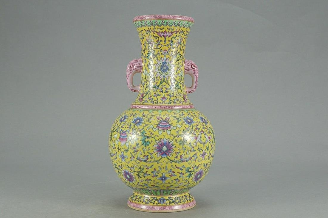 YELLOW GROUND FAMILLE ROSE 'FLORAL SCROLL' VASE WITH