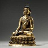 ANCIENT TIBETAN,GILT-BRONZE BUDDHA STATUE