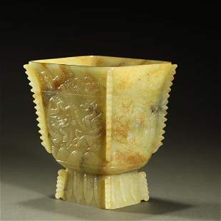 MING DYNASTY,WHITE AND RUSSET JADE CARVED DRAGON FOOD