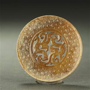WARRING STATES PERIOD,A FINE AND RARE CARVED JADE