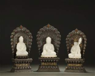 QING DYNASTY,A SET OF WHITE JADE BUDDHAS AND SILVER