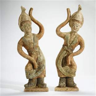 TANG DYNASTY,A PAIR OF PAINTED POTTERY FIGURES